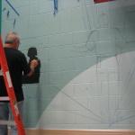 Emanuel Sketching on wall